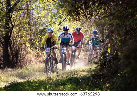 ALMATY, KAZAKHSTAN - OCTOBER 18: Sergey Boronin (2nd L) and other in action at cross-country mountain bike 'Apple race' October 18, 2009 in Almaty , Kazakhstan. - stock photo