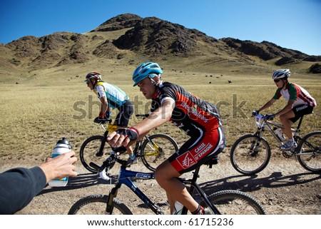 "ALMATY, KAZAKHSTAN - SEPTEMBER 05: A.Kozirev(N47) and other in action at Adventure mountain bike cross-country marathon ""Marathon Bartogay-Assy-Batan 2010"" on September 05, 2010 in Almaty, Kazakhstan. - stock photo"