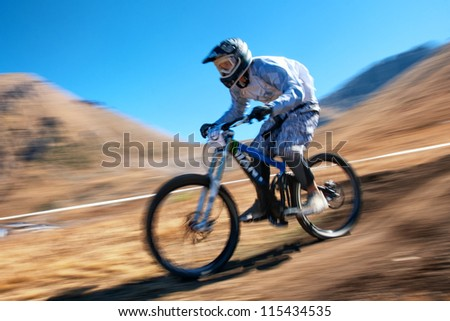 "ALMATY, KAZAKHSTAN - SEPTEMBER 16: A.Sadvokasov (N17) in action at ""Open Championship in Almaty - DOWNHILL"" in Almaty, Kazakhstan, September 16, 2012."
