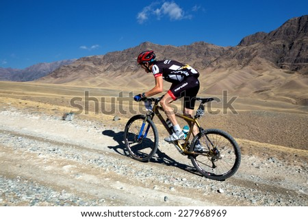 "ALMATY, KAZAKHSTAN - SEPTEMBER 09, 2014: G.Bakhytbekuly (N35) in action at Adventure mountain bike cross-country marathon ""Marathon Bartogay-Assy-Batan""  - stock photo"