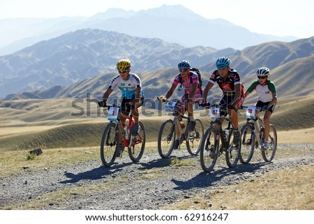 "ALMATY, KAZAKHSTAN - SEPTEMBER 05:K.Khzantcev(N1) and other in action at Adventure mountain bike cross-country marathon ""Marathon Bartogay-Assy-Batan 2010"" on September 05, 2010 in Almaty, Kazakhstan. - stock photo"