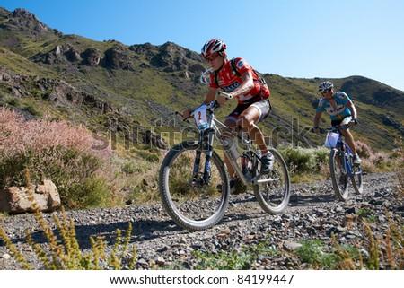 "ALMATY, KAZAKHSTAN - SEPTEMBER 04: M.Dzolba (N2) in action at Adventure mountain bike cross-country marathon in mountains ""Marathon Bartogay-Assy-Batan 2011"" September 04, 2011 in Almaty, Kazakhstan. - stock photo"