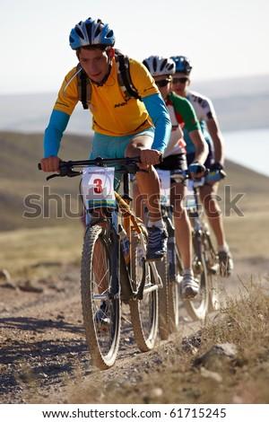 "ALMATY, KAZAKHSTAN - SEPTEMBER 05: Maxim Dzolba (N3) in action at Adventure mountain bike cross-country marathon ""Marathon Bartogay-Assy-Batan 2010"" on September 05, 2010 in Almaty, Kazakhstan. - stock photo"