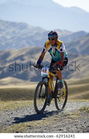 """ALMATY, KAZAKHSTAN - SEPTEMBER 05: P.Nevdah(N48) in action at Adventure mountain bike cross-country marathon """"Marathon Bartogay-Assy-Batan 2010"""" on September 05, 2010 in Almaty, Kazakhstan. - stock photo"""