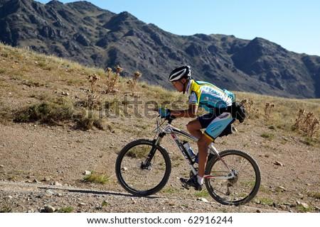 "ALMATY, KAZAKHSTAN - SEPTEMBER 05: T.Amirbekov(N28) in action at Adventure mountain bike cross-country marathon ""Marathon Bartogay-Assy-Batan 2010"" on September 05, 2010 in Almaty, Kazakhstan. - stock photo"