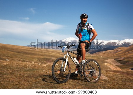 "ALMATY, KAZAKHSTAN - SEPTEMBER 13: Timur Jurkashev (N12) in action at Adventure mountain bike cross-country marathon ""Marathon Bartogay-Assy-Batan 2009"" on September 13, 2009 in Almaty, Kazakhstan. - stock photo"