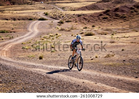 "ALMATY, KAZAKHSTAN - SEPTEMBER 09, 2014: V.Ganja (N3) in action at Adventure mountain bike marathon ""Marathon Bartogay-Batan"".  NOTE: Photo was taken with the effect of motion blur to show dynamics  - stock photo"