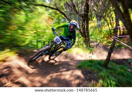 "ALMATY, KAZAKSTAN - AUGUST 03: D.Gafurov (N10) in action at  Mountain Bike sports event Superiority of ""Cycling club named A.Vinokurov"" Downhill in Almaty, Kazakstan Aug 03, 2013. - stock photo"