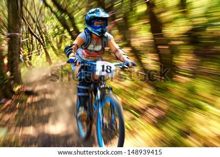 "ALMATY, KAZAKSTAN - AUGUST 03: I.Habarova (N18) in action at  Mountain Bike sports event Superiority of ""Cycling club named A.Vinokurov"" Downhill in Almaty, Kazakstan Aug 03, 2013. - stock photo"