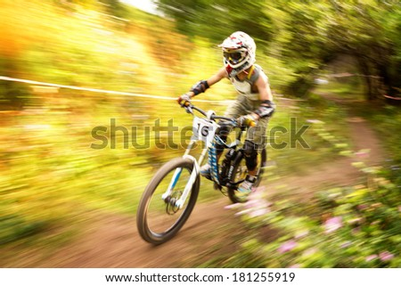 "ALMATY, KAZAKSTAN - AUGUST 03: V.Li (N16) in action at Mountain Bike sports event Superiority of ""Cycling club named A.Vinokurov"" Downhill in Almaty, Kazakstan Aug 03, 2013.  - stock photo"
