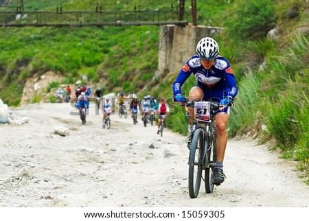 Almaty, Kazakstan - JUNE 29: Mountain Bike Adventure Uphill Race June 29, 2008 in Almaty, Kazakstan. - stock photo