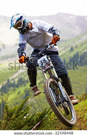 ALMATY, KAZAKSTAN - JUNE 21: Stepan Dionisyev (N38) in action at CITY CHAMPIONSHIP ALMATY MOUNTAIN BIKE DOWNHILL in Almaty, Kazakstan June 21, 2009. - stock photo