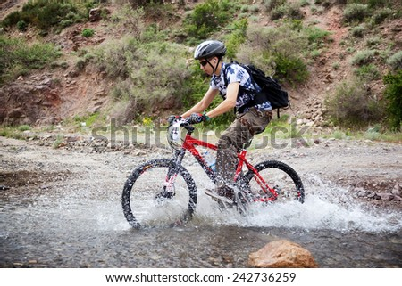 "ALMATY, KAZAKSTAN - MAY 01, 2010: A.Shvedov (N21) in action at Adventure mountain bike cross-country competition in mountains ""Jeyran Trophy 2010""  - stock photo"