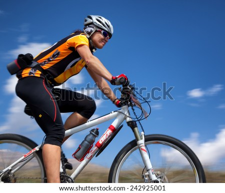 "ALMATY, KAZAKSTAN - MAY 01, 2011: G.Balagurova (N28) in action at Adventure mountain bike cross-country marathon in mountains ""Jeyran Trophy 2011""  - stock photo"