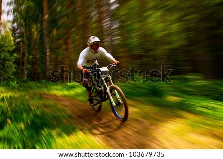 ALMATY, KAZAKSTAN - MAY 26: J.Kumakbayev (N19) in action at Freestyle Bike Session in Almaty, Kazakstan MAY 26, 2012. - stock photo