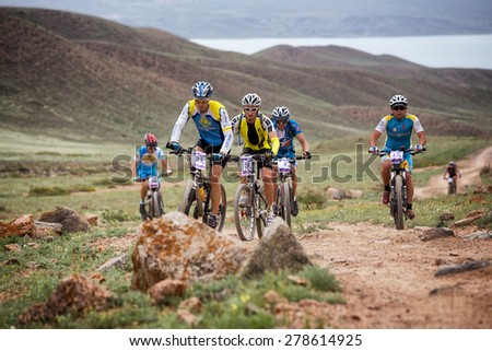 "ALMATY, KAZAKSTAN - MAY 02, 2015: N.Tlegenov (N21) in action at Adventure mountain bike cross-country marathon in mountains ""Jeyran Trophy 2015""  - stock photo"