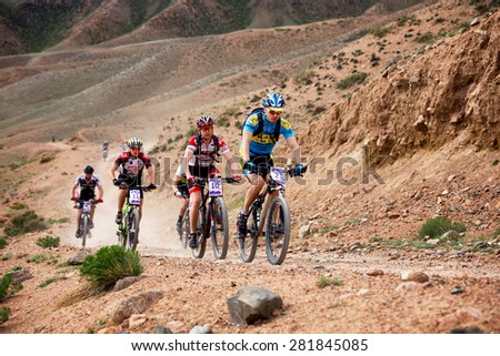 "ALMATY, KAZAKSTAN - MAY 03, 2015: N.Tlegenov (N21) in action at Adventure mountain bike cross-country marathon in mountains ""Jeyran Trophy 2015""  - stock photo"