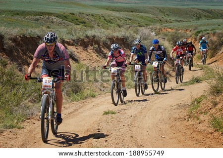 "ALMATY REGION, KAZAKHSTAN -  MAY 5, 2013: i.Popov (N2) and other in action at Adventure mountain bike cross-country marathon in mountains ""Jeyran Trophy 2013"". - stock photo"