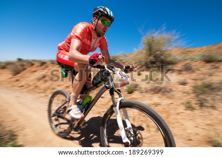 "ALMATY REGION, KAZAKHSTAN - MAY 5, 2013: T.Dauranov (N10) in action at Adventure mountain bike cross-country marathon in mountains ""Jeyran Trophy 2013""."
