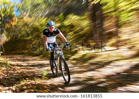 "ALMATY REGION, KAZAKHSTAN - OCTOBER 13: N.Tlegenov (N169) in action at mountain bike sports event ""Red Bull Mountain Rage"" October 13, 2013 in Almaty region, Kazakhstan.  - stock photo"