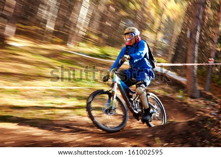 "ALMATY REGION, KAZAKHSTAN - OCTOBER 13: P.Rozbitsky (N65) in action at  mountain bike sports event ""Red Bull Mountain Rage"" October 13, 2013 in Almaty region, Kazakhstan. - stock photo"