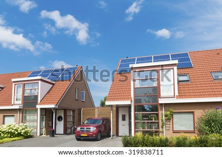 ALMELO, NETHERLANDS - AUGUST 8, 2015: modern residential houses with solar panels on the roof - stock photo
