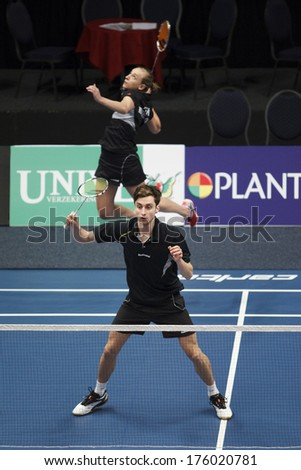 ALMERE - FEBRUARY 1: Jacco Arends (front) and Selena Piek (back) reach the semi finals in the National Championships badminton 2014 in Almere, The Netherlands on February 1, 2014. - stock photo
