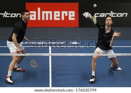 ALMERE - FEBRUARY 1: Jelle Maas (left) and Jacco Arends (right) reach the semi finals in the National Championships badminton 2014 in Almere, The Netherlands on February 1, 2014. - stock photo