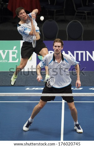 ALMERE - FEBRUARY 2: Koen Ridder (left) and Ruud Bosch (right) win the silver medal in the National Championships badminton 2014 in Almere, The Netherlands on February 2, 2014. - stock photo