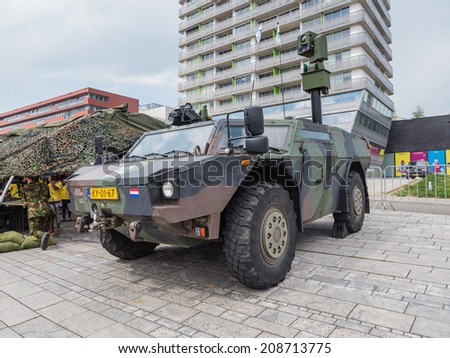 ALMERE, NETHERLANDS - 23 APRIL 2014: A Dutch Fennek military armored reconnaissance vehicle on display during the National Army Day in Almere can be inspected by the general public at close range - stock photo