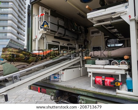 ALMERE, NETHERLANDS - 23 APRIL 2014: A Dutch military medical vehicle on display during the National Army Day in Almere can be inspected by the general public at close range - stock photo