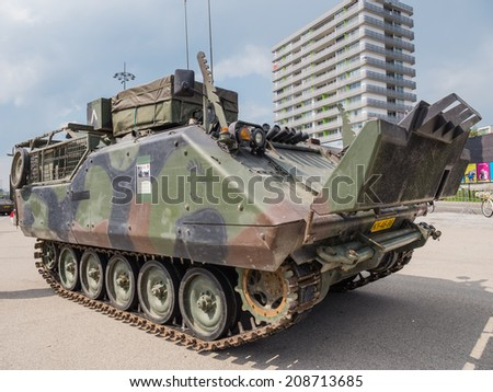 ALMERE, NETHERLANDS - 23 APRIL 2014: Dutch military armored fighting vehicle on display during the National Army Day in Almere can be inspected by the general public at close range - stock photo