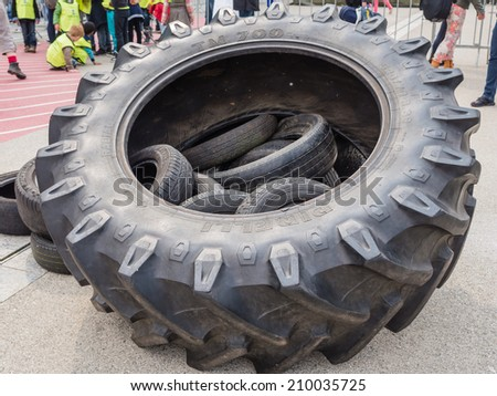 ALMERE, NETHERLANDS - 23 APRIL 2014: Huge military truck tires  on display during the National Army Day in Almere can be inspected by the general public at close range - stock photo