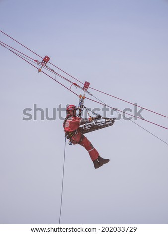 ALMERE, NETHERLANDS - 12 APRIL 2014: Rescue workers during an abseiling demonstration at the first National Security Day held in the city of Almere - stock photo