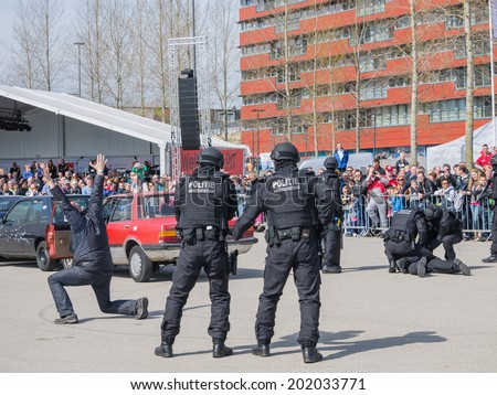 ALMERE, NETHERLANDS - 12 APRIL 2014: SWAT team during a demonstration of an enacted robbery at the first National Security Day held in the city of Almere - stock photo