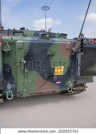 ALMERE, NETHERLANDS - 12 APRIL 2014: The back of a Dutch military armored fighting vehicle on display during the first National Security Day held in the city of Almere - stock photo