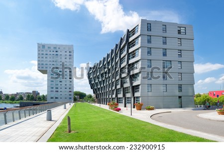 ALMERE, NETHERLANDS - AUGUST 3, 2014: Exterior of modern apartment buildings. Almere is the youngest city in the netherlands and lies completely below sea level (2 to 5 meters) - stock photo