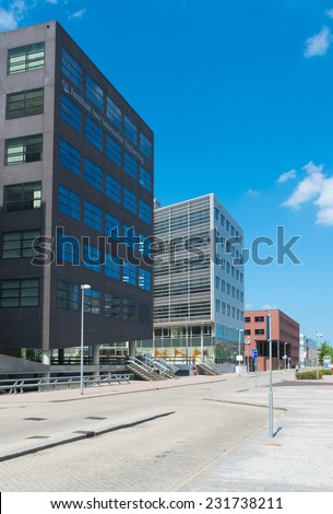 ALMERE, NETHERLANDS - AUGUST 3, 2014: Modern office buildings. It is the youngest and fastest growing city in the country, founded around 1975.