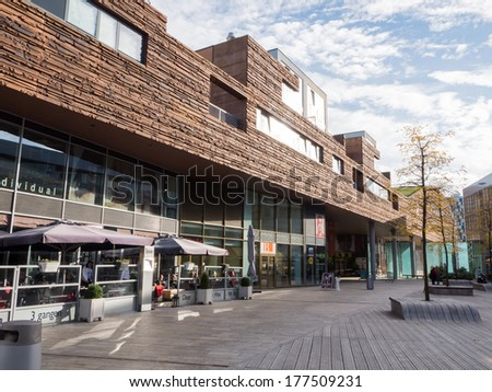 ALMERE, NETHERLANDS - 26 OCT. 2013: People shopping in the modern city centre of Almere, Flevoland, the youngest and fastest growing city in the Netherlands, where construction began in 1975 - stock photo