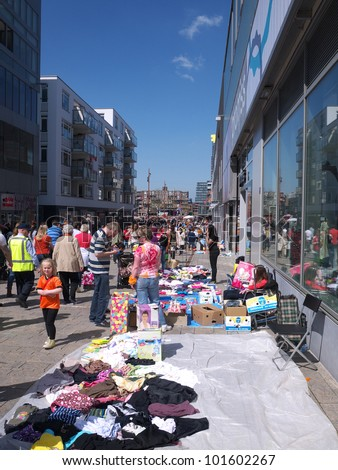 ALMERE, THE NETHERLANDS - APRIL 30, 2012: Flea market on Queen's Day, a national Dutch holiday to clebrate the Queen's birthday in Almere, The Netherlands on April 30, 2012