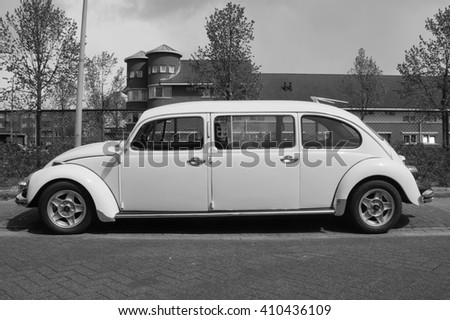 Almere, The Netherlands - April 24, 2016: White Volkswagen stretched Beetle Limousine parked on a public parking lot in the city of Almere.  - stock photo