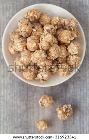 Almond and caramel popcorn on tablecloth background