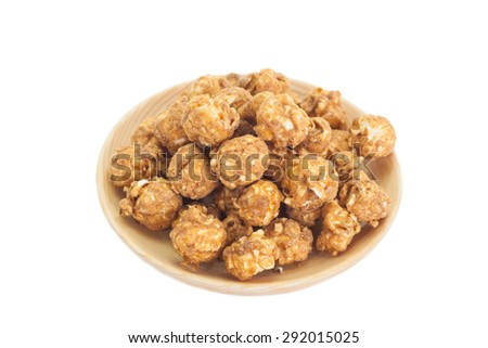 Almond and caramel popcorn on white background