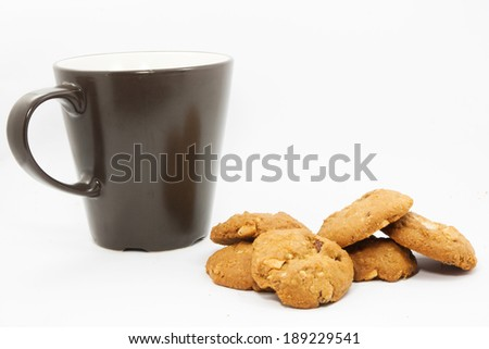 Almond butter cookies with cup of tea - stock photo