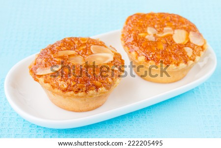 Almond Cake, Almond with Banana Cake, Fresh Almond Bakery Cake, Banana Cake Topped with Almonds or Almond banana bread on white plate, Sweet and Snack for tea time  - stock photo