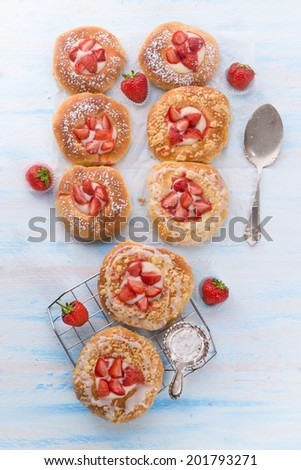 Almond cakes with vanilla and strawberries - stock photo