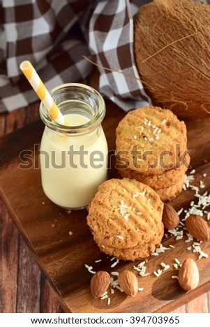 Almond coconut cookies with a bottle of milk - stock photo