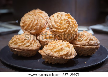 Almond cookies on wooden table. Shallow DOF and lightly toned. - stock photo