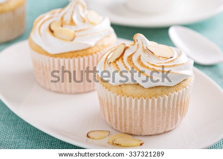 Almond cupcakes with meringue tops fluffy and light - stock photo