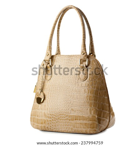 Almond female handbag isolated on white background.